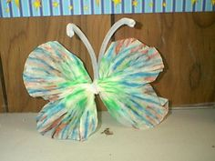 Coffee Filter Butterfly    This simple little crafts was made with two large coffee filters draw on with markers, wet with water, dried out then secured with a large pipe cleaner.   It is a fun summer camp craft.