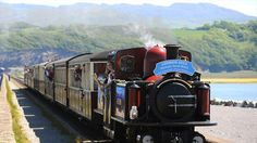 The Olympic Flame travels on the Ffestiniog Railway from Blaenau Ffestiniog to Porthmadog during the Olympic Torch Relay.