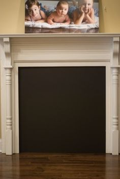 Fake fireplace with blackboard