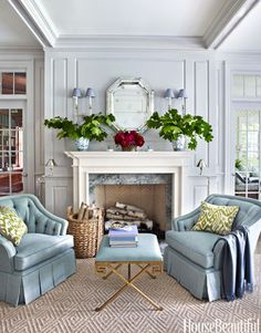 Cozy Spot In the living room of a Greenwich, Connecticut, house, designer Ashley Whittaker created a cozy spot for two with a pair of the homeowners' favorite chairs and a Currey & Company Circe bench.
