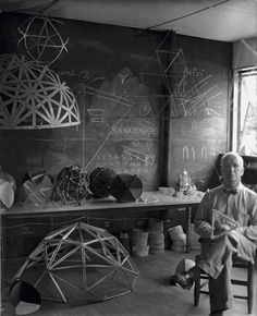 Buckminster Fuller (July 12, 1895 – July 1, 1983) was an American architect, systems theorist, author, designer, inventor, and futurist.  Bucky is depicted, here, in his classroom at Black Mountain College.