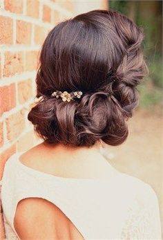 Love how the curls roll up and in. Perfect vintage or bohemian wedding hairstyle for a bride or bridesmaids. #bridalhair #bridal #weddinghairstyle