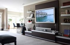 idea for the entertainment center with the floating shelves. http://www.houzz.com/photos/family-room/p/16