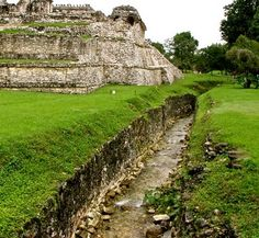 The aqueduct, another Palenque achievement. This stream, called the Otulum, runs out of the high hills behind Palenque and through the heart of the city.Tiring of floods,at some point the Maya rulers of Palenque built stone on either side of the stream for a considerable distance to channel and control the water.Here,its runs along the east side of the Palace,wich no doubt made water gathering for the Palace inhabitants easy.