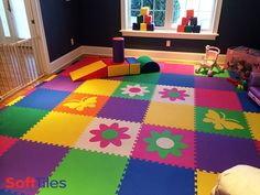 Start thinking about Spring with this large, colorful, kids playroom floor that uses SoftTiles Flower Foam Mats and Butterfly Die-Cuts as accent pieces. #playrooms