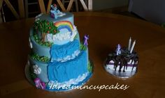 my little pony - 3 tier stacked topsy turvy waterfall cake, decorated with the my little pony theme for a 2 year old birthday. Additional personal cake slice cake with ganache topping.