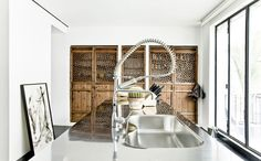 This townhouse conversion in the Lower East Side, New York, was once an old Jewish school turned into a home with an art gallery, by Labo Design Studio. Küchen Design, Tile Design, Bath Design, Studio Kitchen, Kitchen Sink, Kitchen Cabinets, Home Building Design, Loft, Best Kitchen Designs
