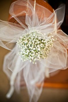 baby's breath and tulle bow pew markers. Also have seen tulle and baby's breath draped and I liked it