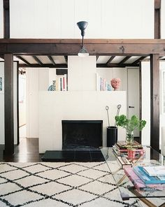i love any room with a beni ourain rug. http://www.etsy.com/shop/bringyourownsunshine