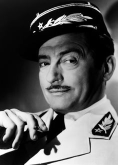 "Claude Rains as Captain Renault in ""Casablanca"": ""Round up the usual suspects!"""