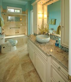Tiffany Blue Bathroom  This bathroom—created for a teenage girl—was inspired by a Tiffany & Co. jewelry box. The floors tiles are made from travertine and the EuroCraft vanity cabinets are painted in eggshell with a butterscotch glaze.