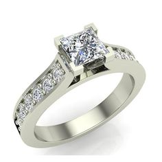 Beautifully crafted, this diamond engagement ring features ten brilliant round sparkling white accent diamond pavé-set in 14K Gold with a raised cathedral design to frame your center white diamond which is a princess cut. For more information on this product: https://www.glitzdesign.us/collections/side-stone-accent-diamond-rings/products/glitz-design-five-stone-natural-diamond-engagement-solitaire-ring-yellow-white-gold-g-h-vs1-vs2 To see other products go to www.glitzdesign.us