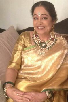 Kiron Kher in gold Kanjeevaram Saree of a Gaurang Shah. I think the stylist messed up the heavy jewellery with a jhakas bindi n a gold Saree. But her smile takes care of the goof up!!! Description by Pinner Mahua Roy Chowdhury