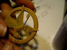 """Tutorial: Mockingjay Pin made with polymer clay (from """"The Hunger Games"""") this is AMAZING."""