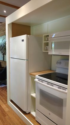 The kitchen is equipped with full-size appliances, floating cabinets, a utility closet, and 9' of counter space.