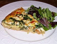 Winner of Green Tomato Recipe Contest - Real Food - MOTHER EARTH NEWS: Green Tomato Tart (sort of a quiche) Goat cheese and spinach, too.