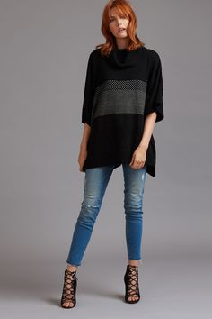 Summer-to-fall's ultimate transitioning piece? This turtleneck poncho.