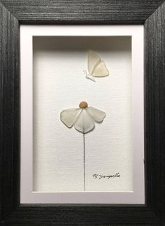 Fluttering sea glass flower and butterfly