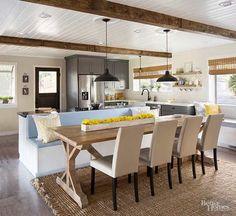 Yes, you can remodel your house using only DIY projects! Get inspiration from this real-life remodel full of cool DIY projects such as a table made from reclaimed wood, tiled walls, DIY wood beams, a redesigned fireplace and thrifted and upcycled furniture.