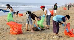 Do a beach clean-up with a group of people.