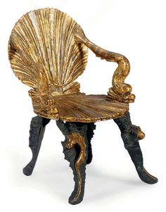 AN ITALIAN GILTWOOD AND EBONIZED GROTTO CHAIR 19TH CENTURY The back and seat in scallop-shell form with arms of upturned dolphins and on coral legs,