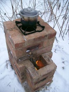Rocket Stoves are very efficient wood-burning devices that generally use a J shape design for the combustion unit to achieve high temperatures and clean burn. The heat generated can be piped throug… Mehr Next Post Previous Post Rocket Stoves & Earth Ove Outdoor Kocher, Outdoor Projects, Outdoor Decor, Outdoor Living, Outdoor Patios, Outdoor Rooms, Diy Projects, Outdoor Stove, Rocket Stoves