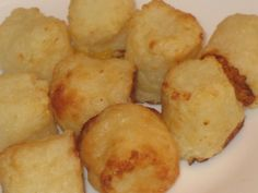 Cauliflower Tater Tots 1 12 ounce bag frozen cauliflower 1/3 cup grated Parmesan Cheese salt, pepper, onion powder (to taste)