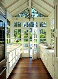 white galley kitchen with natural light