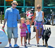 The Madden-Richie clan ran errands around Los Angeles with their canine pal in tow! Lovin' Joel's wayfarer shades and Nicole's oversized cat-eyes! The kiddies need sunnies too!