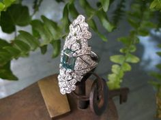 """Awe inspiring 1920's 5.00 carat blue zircon elongated cocktail ring (approximately 2"""" in length) with 2.75 carats total weight in diamonds set in platinum."""