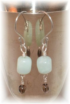 Amazonite (nugget) & Smoky Quartz (4mm) Earrings, on Sterling Silver headpin & eyepin, and Hand-made Stainless Steel Fish Hooks - $8.00 at: www.ETSY.com/shop/HarpersCauldron.  Amazonite is a soft blue, soothing stone, associated with the throat or brow chakra. It is a powerful filter, and helps block electromagnetic pollution. Smoky Quartz is a grounding stone, associated with the base chakra. It helps neutralize negativity and electromagnetic stress, and helps with dextoxification.
