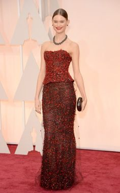 Behati Prinsloo in a red & black embellished Armani Prive peplum corset strapless gown.