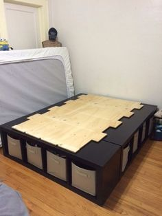 A bed made from 3 storage cubes and a piece of plywood.... Brilliant!