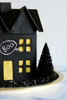 Haunted Halloween House - Use this paper mache house and chalkboard paint to make this halloween house by @Jenny Batt