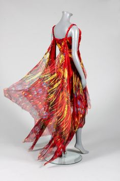 An Alexander McQueen 'Irere' collection evening gown, Summer, 2003 of red and yellow sheer with what almost look like butterfly wings floating behind you. <---I was thinking it looked like flames, campfire anyone?, but butterfly works. Unique Fashion, Fashion Design, Funky Fashion, Alexander Mcqueen Savage Beauty, Formal Wear Women, Chiffon Skirt, British Style, Evening Gowns, Alexander Macqueen