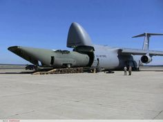 C-130 fuselage transported in a C-5. Use to see these a lot when at Elmendorf AFB in Alaska.