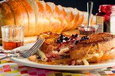 We paired smoky-sweet griddled country ham, gooey melted fontina, or white cheddar cheese, and creamy maple Dijon sauce together for our Monte Cristo sandwich and then drenched it in real maple syrup for the perfect brunch or late-night sandwich recipe. Monte Cristo Sandwich, New Hampshire, Ham Sandwich Recipes, Sandwich Ideas, Fried Ham, Honey Wheat Bread, Homemade Soft Pretzels, Real Maple Syrup, Toast Sandwich