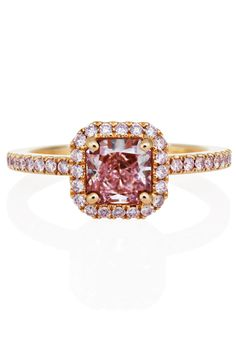 Brides: De Beers. This stunning 2.2 mm (0.09 in.) wide pink gold ring is prong set with a pink cushion-cut diamond solitaire embraced by a sparkling micropavéd halo setting.See more info at DeBeers.com