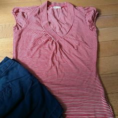American Rag Red Stripe Top Cuff sleeves. Size M. 50% polyester 50 % rayon. Used in good condition.  No rips or stains. American Rag Tops Blouses