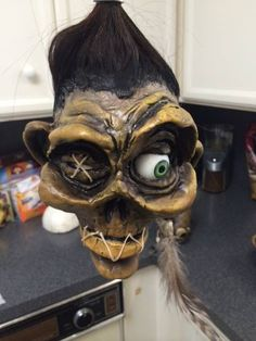 Thanks I keep picking up little bits of advice all over the place on sculpting, some of it was bound to stick. Halloween Doll, Halloween Party Decor, Halloween Crafts, Voodoo, Tiki Art, Tiki Tiki, Clay Monsters, Shrunken Head, Creepy Dolls