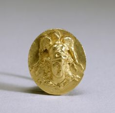 This gold ring depicts the Greek goddess of wisdom and war, Athena, in a lively manner-- with flowing hair, a large triple-crested helmet, and the characteristic aegis (shield or breastplate) around her neck. 3rd  cent BC