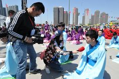 A boy from Taiyuan is participating in a traditional Chinese coming of age ceremony where he receives a crown. This ceremony was part of the 2nd Shanxi Radio and TV Carnival in China.