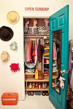 Who needs a dressing room when you can have a closet this gorgeous? Love the turquoise door!