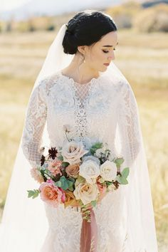 """From the editorial """"Think Ranch Wedding Venues Are Too Rustic? Think Again."""" From the bride's long sleeved beaded gown to the gorgeous mountain ranch views, everything about both this ceremony and reception will leave you absolutely speechless. 😍  Photography: @sophiekayephotography  #beadedweddingdress #longsleeveweddingdress #bridedress #weddinggown #fallweddingdress Dark Red Wedding, Burgundy Wedding, Classic Wedding Gowns, Fall Wedding Dresses, Bridal Beauty, Wedding Beauty, Dream Wedding, Destination Wedding, Wedding Venues"""