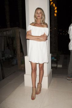 Rosie Huntington-Whiteley looked tanned and toned in a simple white dress on April 11, 2014.