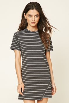 A knit T-shirt dress featuring an allover striped pattern, a round neckline, short sleeves, and an asymmetrical wrapped hem.