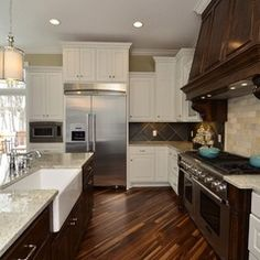 i like the farmhouse sink, hardwood floors, stainless steel appliances