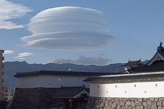"""THIS rare hat-shaped cloud that hung in the sky over Japan was caused by a strong typhoon that swept through the country.  The formation is called """"tsurushi-gumo"""" which means hanging cloud.  Scientists say the phenomenon occurs when winds around Mount Fuji reach a certain strength, or they can be caused by tropical storms.  from the BBC"""