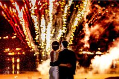 The bride and groom looking at their firework display over Downings Bay, Co Donegal, Ireland. Photo by Paul McGinty from Ghorm Studio Photography available for wedding and elopement in Ireland