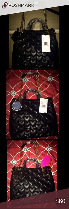 """*New* Betsey Johnson """"Bee Mine"""" Tote, Black Betsey Johnson """"Bee Mine"""" Heart-Quilted Shopper Bag, in black. This bag has golden hardware and a chain shoulder strap with a hanging floral charm, which has a mirror on one side that says """"Hey, good looking!"""". The shoulder strap has an 11"""" drop. The bag has an open top with a snap-tab closure. Measurements are: 9.8""""H x 11""""W x 5.5""""D; weighs 1 lb. 14.8 oz. Betsey Johnson Bags Totes"""